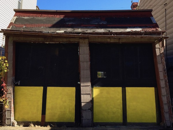 older 2-car garage with doors painted black and gold, Pittsburgh, PA