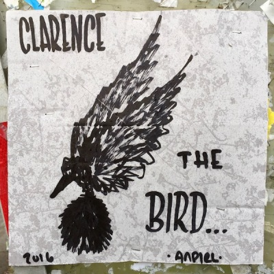 Clarence the Bird artwork stapled to info kiosk, Pittsburgh, PA