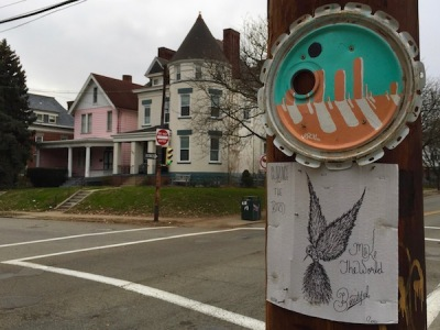 "cardboard ""Clarence the Bird ... Make the World Beautiful"" artwork stapled to telephone pole, Pittsburgh, PA"
