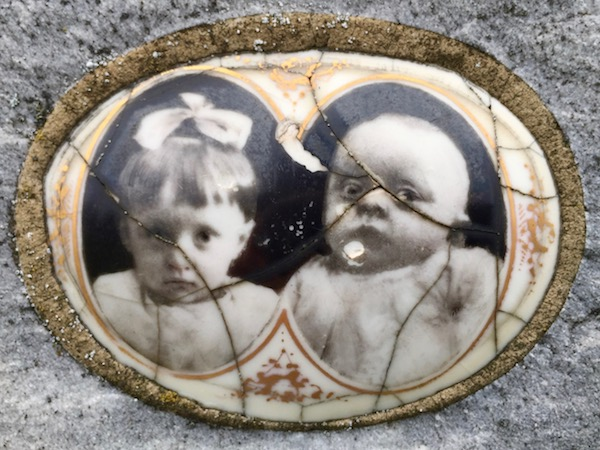 detail of marble headstone with embedded ceramic photograph of a young girl and baby, Loretto Cemetery, Pittsburgh, PA