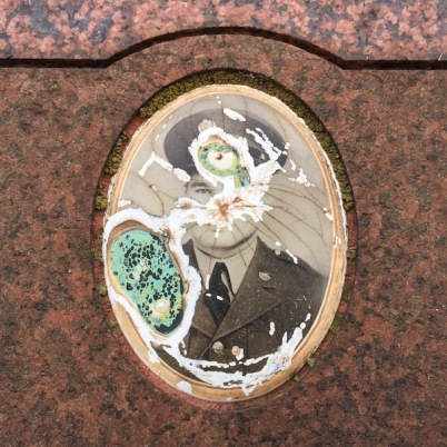 detail from granite headstone with embedded ceramic photograph of man in military dress, Loretto Cemetery, Pittsburgh, PA