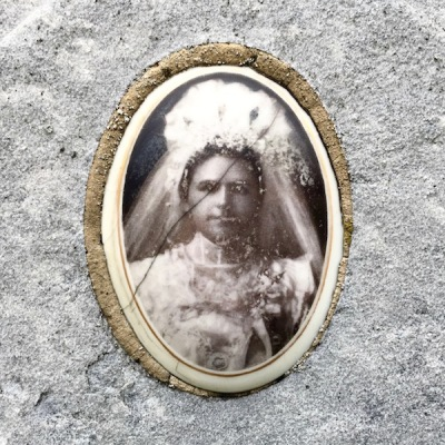 detail from marble headstone with embedded ceramic photograph of a woman in bridal gown, Loretto Cemetery, Pittsburgh, PA