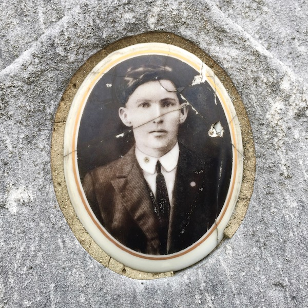 detail from marble headstone with embedded ceramic photograph of young man, Loretto Cemetery, Pittsburgh, PA