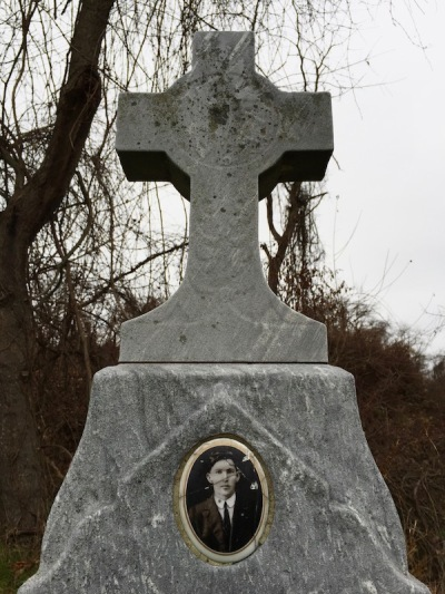 ceramic photograph with image almost completely disappeared on headstone of grave, Loretto Cemetery, Pittsburgh, PA