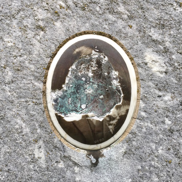 ceramic photograph with image vandalized on headstone of grave, Loretto Cemetery, Pittsburgh, PA