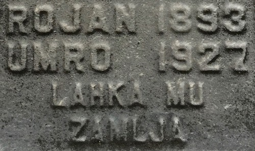 "detail from headstone reading ""Rojan 1893 - Umro 1927 - Lahka mu zamlja"", Loretto Cemetery, Pittsburgh, PA"