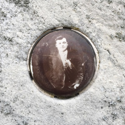 detail of marble headstone with embedded ceramic photograph of young man, Loretto Cemetery, Pittsburgh, PA