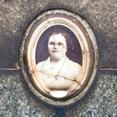 detail of marble headstone with embedded ceramic photograph of woman, Loretto Cemetery, Pittsburgh, PA