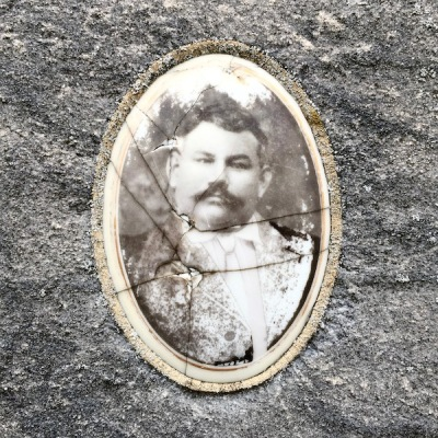 detail of marble headstone with embedded ceramic photograph of older man, Loretto Cemetery, Pittsburgh, PA