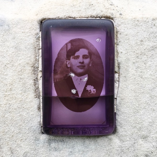 detail of marble headstone with embedded ceramic photograph of young man protected by purple plastic cover, Loretto Cemetery, Pittsburgh, PA