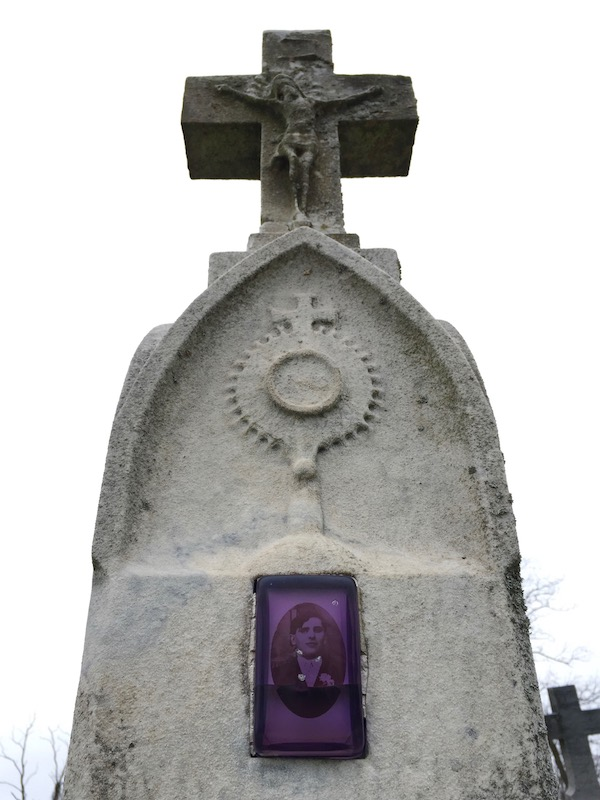 marble headstone with embedded ceramic photograph of young man protected by purple plastic cover, Loretto Cemetery, Pittsburgh, PA