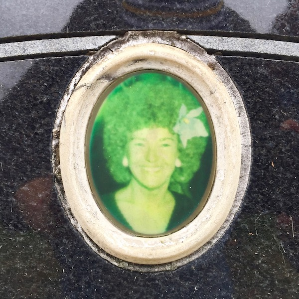 detail of granite headstone with embedded ceramic photograph of woman, Loretto Cemetery, Pittsburgh, PA