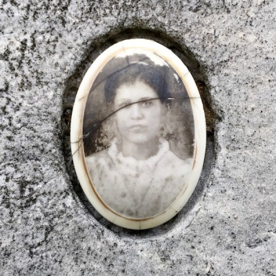 detail of marble headstone with embedded ceramic photograph of young woman, Loretto Cemetery, Pittsburgh, PA