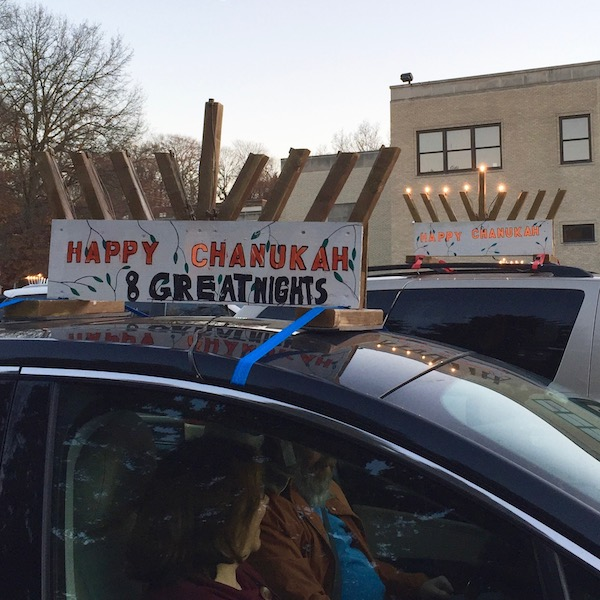 """Two cars with rooftop menorahs and home made """"Happy Chanukah"""" signs, Pittsburgh, PA"""