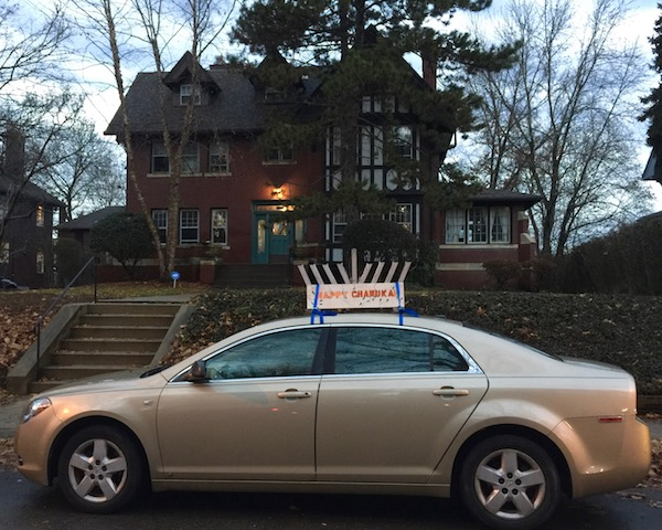 """sedan with menorah and """"Happy Chanukah"""" sign on roof, Pittsburgh, PA"""