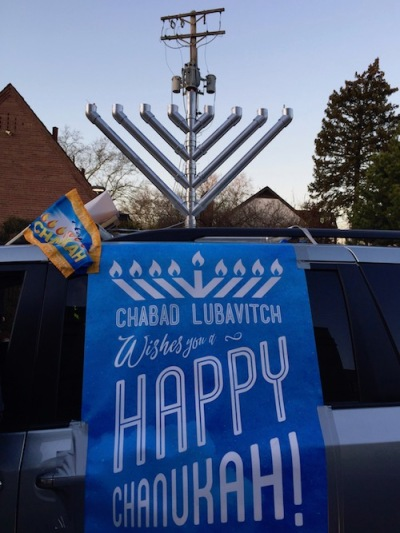 "mini van with rooftop menorah and ""Happy Chanukah"" banner, Pittsburgh, PA"
