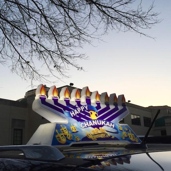 car with plastic rooftop menorah, Pittsburgh, PA