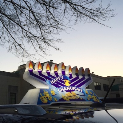 car with plastic rooftop menorah, Pittsburgh, PA