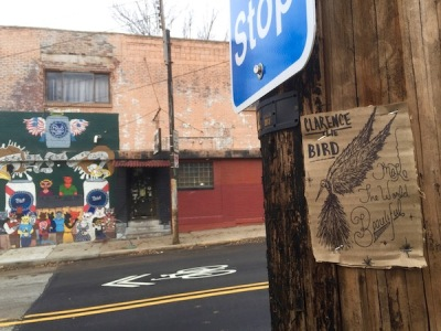 cardboard Clarence the Bird drawing stapled to telephone pole, Pittsburgh, PA