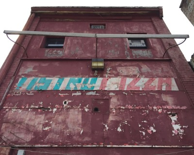 "rear of commercial building with hand-painted sign reading ""Astro Pizza"", Pittsburgh, PA"
