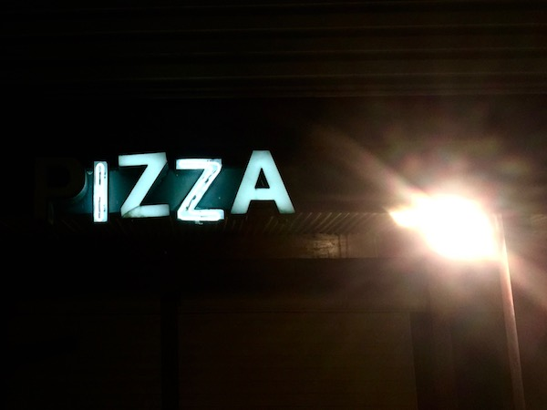 "neon sign reading ""IZZA"" (the letter ""P"" is burnt out), Natrona Heights, PA"