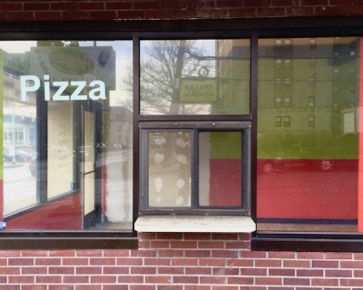 "empty glass storefront with the word ""Pizza"" on glass, Pittsburgh, PA"