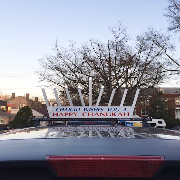 """car with rooftop menorah reading """"Chabad wishes you a happy Chanukah"""", Pittsburgh, PA"""