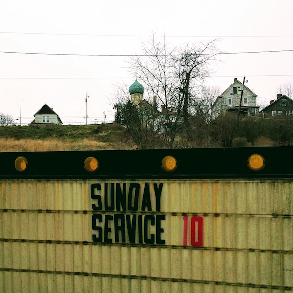"""foreground sign with removable letters saying """"Sunday service 10"""" with St. Nicholas Orthodox Church in background, Donora, PA"""