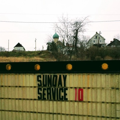 "foreground sign with removable letters saying ""Sunday service 10"" with St. Nicholas Orthodox Church in background, Donora, PA"