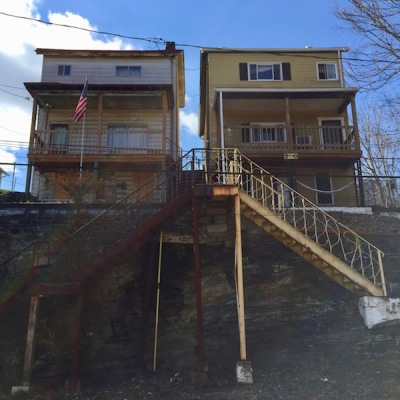 two frame houses with long sets of steel steps to reach the front door, Pittsburgh, PA