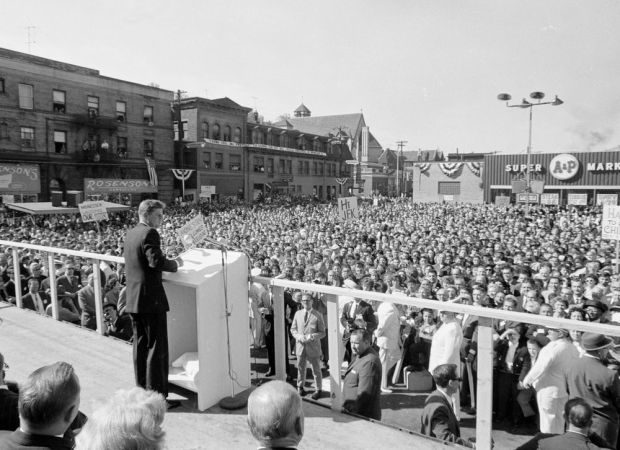 President John F. Kennedy addresses a large outdoor crowd in Monessen, PA, Oct. 13, 1962