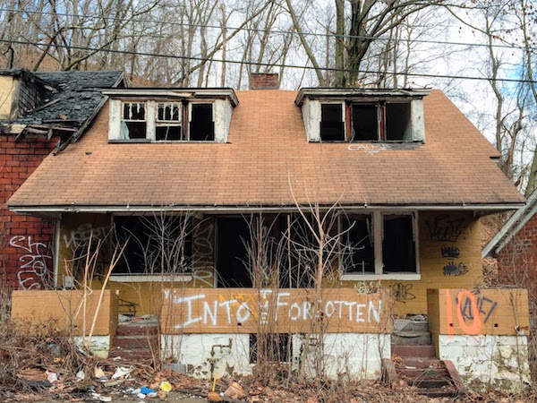 "abandoned house with spray-painted graffiti ""Into the forgotten"", Clairton, PA"