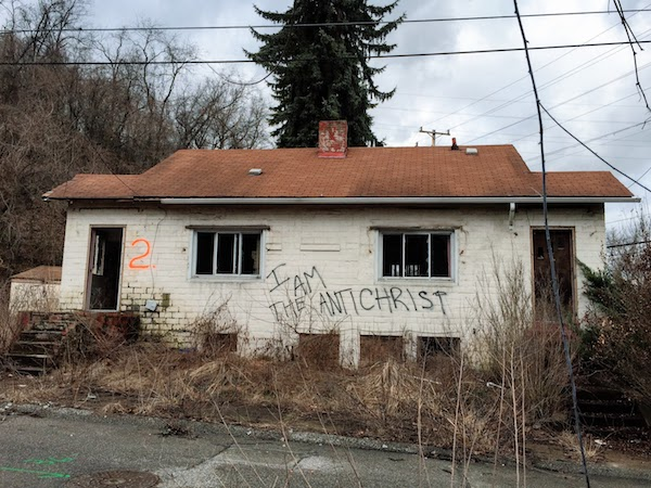 """abandoned house with spray painted graffiti """"I am the antichrist"""", Clairton, PA"""