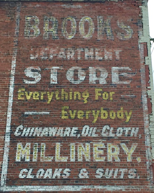 """ghost sign for Brooks Department Store, with text """"Everything for Everybody, chinaware, oil cloth, millinery, cloaks & suits"""", Monessen, PA"""