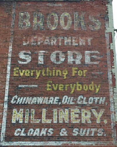 "ghost sign for Brooks Department Store, with text ""Everything for Everybody, chinaware, oil cloth, millinery, cloaks & suits"", Monessen, PA"