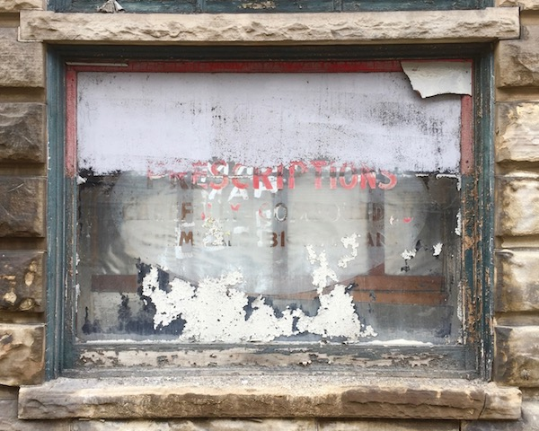 """Old drug store window with word """"Prescriptions"""" painted on glass, Monessen, PA"""