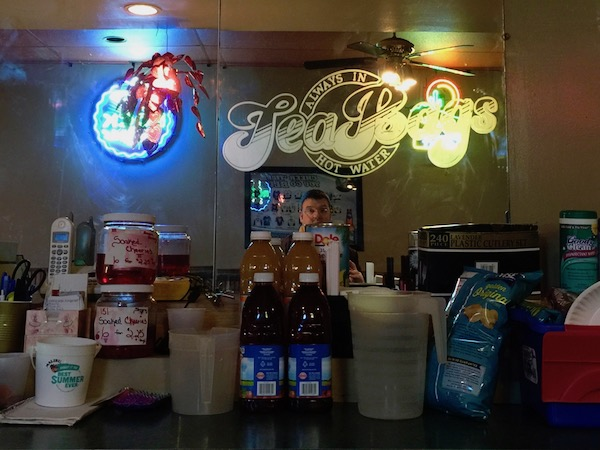 """mirror behind bar with """"Tea Bags - Always in Hot Water"""" logo, Pittsburgh, PA"""