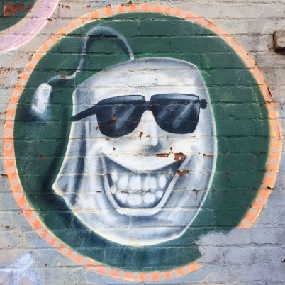 mural detail of anthropomorphized tea bag wearing sunglasses and with wide toothy grin, Tea Bags bar, Pittsburgh, PA