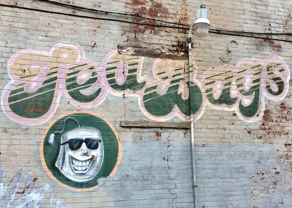 brick wall painted with logo for Tea Bags bar, Pittsburgh, PA
