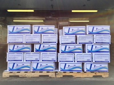 stacks of boxed frozen pollack fillets on shipping pallets