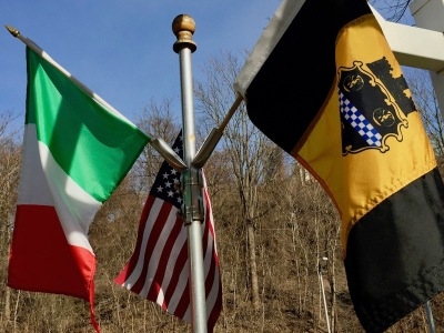 flag pole with miniature flags of Italy, USA, and Pittsburgh