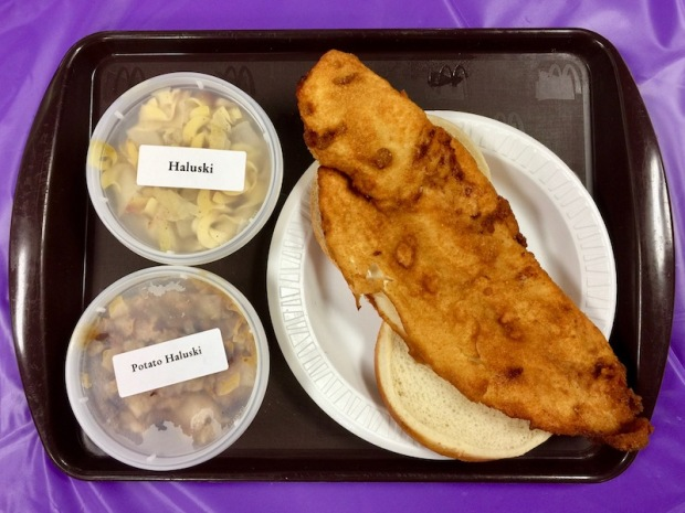fish sandwich with sides of haluski and potato haluski from church fish fry