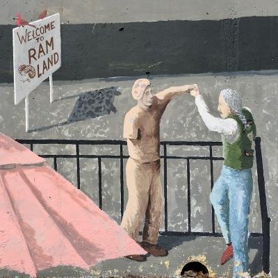 "mural detail of Vietnam War veterans dancing and ""Welcome to RAM LAND"" sign, Tarentum, PA"