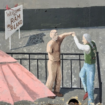 "mural detail of Vietnam War veterans dancing and ""Welcome to RAM LAND"" sign, Tarentum, PA"