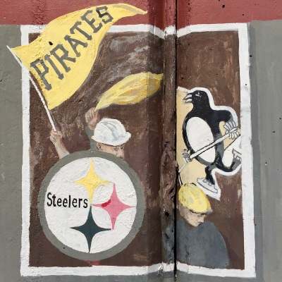 mural detail of Pittsburgh Steelers, Pirates, and Penguins logos, Tarentum, PA