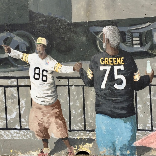 mural detail of two men in Pittsburgh Steelers team jerseys, Tarentum, PA