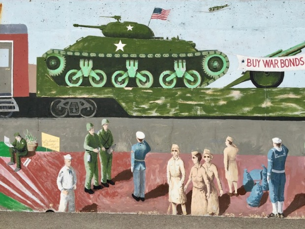 mural of army tank on train car with soldiers, sailors, and WACs on train station platform, Tarentum, PA