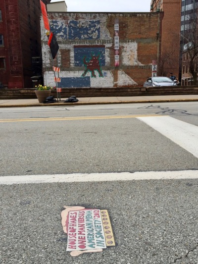 "street art ""Toynbee tile"" and buildings of downtown Pittsburgh, PA"