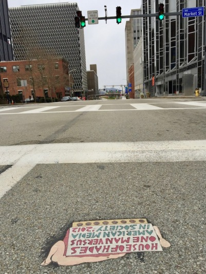 """street art """"Toynbee tile"""" and buildings of downtown Pittsburgh, PA"""