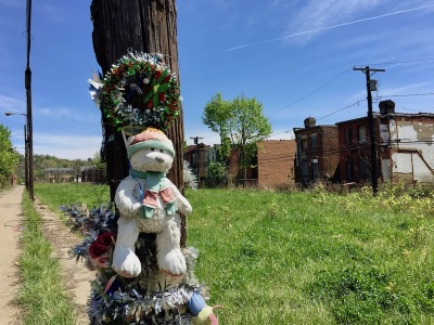 telephone pole decorated with stuffed animals and Christmas garland, Pittsburgh, PA